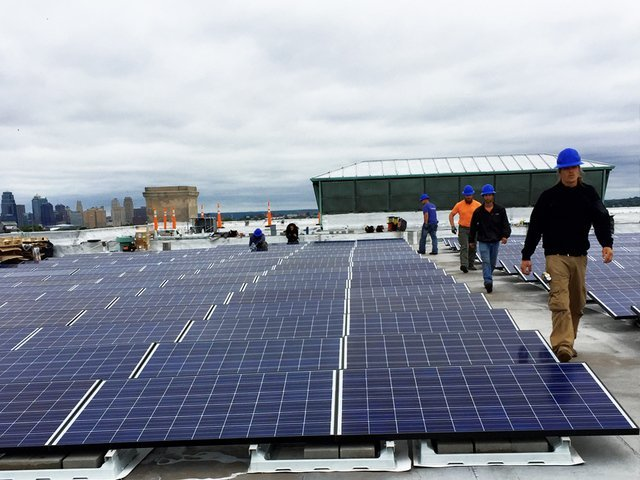 Installing solar panels at the Kansas City Scottish Rite Temple